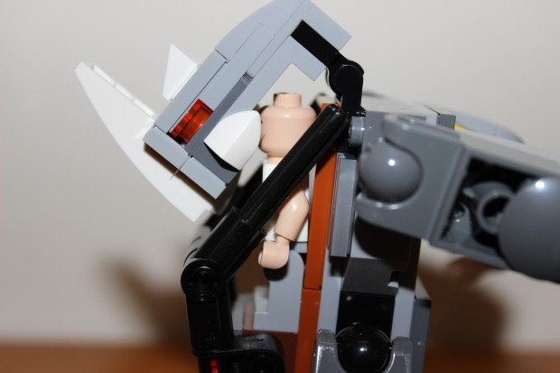 Mini figure inside the Rhino mech with the head providing cover