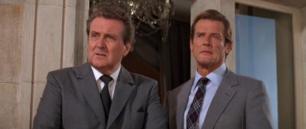Patrick Macnee as Sir Godfrey Tibbett alongside Roger Moore as 007