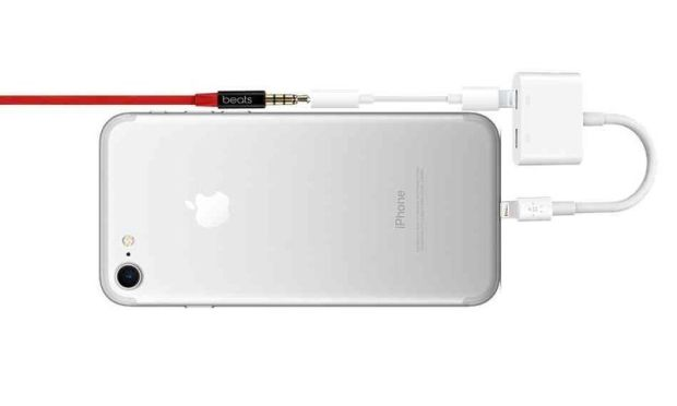 iPhone 7 with lightning splinter with lightning to 3.5mm connection to headphone jack